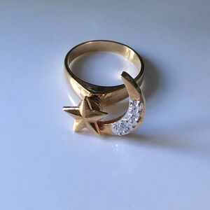 Star and moon gold tone motion ring with stones